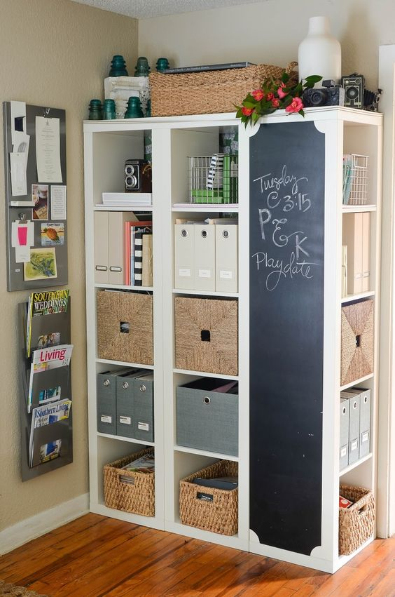 an oversized storage unit with a chalkboard surfaces is a great idea to rock in your home office, get inspired