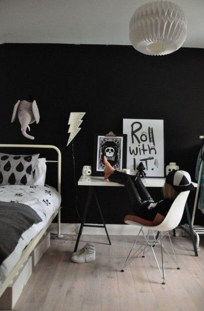 a stylish monochromatic kid bedroom with a chalkboard wall where you can hang any art and decor and offer your kid to use it for more