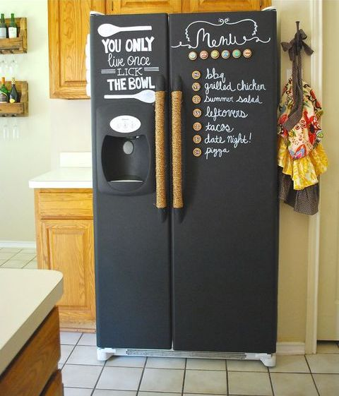 an old fridge renovated with chalkboard paint to leave notes, write down food and drinks and of course recipes