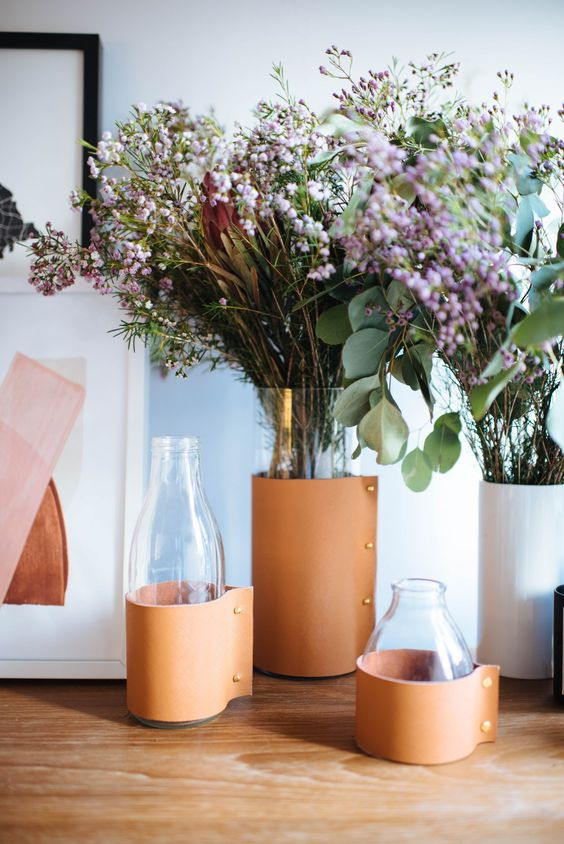 vases and bottles wrapped with leather look catchy and stylish, and such a project is easy to realize at home