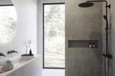 a grey minimalist bathroom clad with large scale tiles, black fixtures, a monolith vanity with a sink and a large window