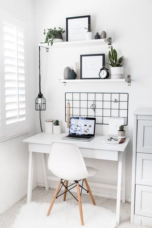 a minimalist meets Nordic home office in white, with open shelves, a desk, a grid and a pendant lamp