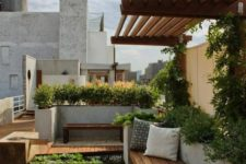a minimalist terrace with a wooden deck, a wooden bench, lots of growing greenery and a waterfall for a zen feel