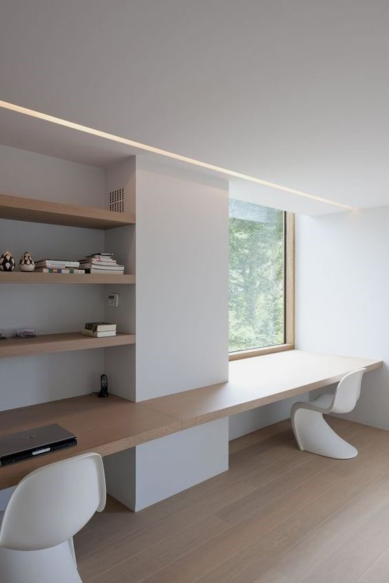 a shared ultra-minimalist home office in white, with curved chairs, open shelves and built-in lights