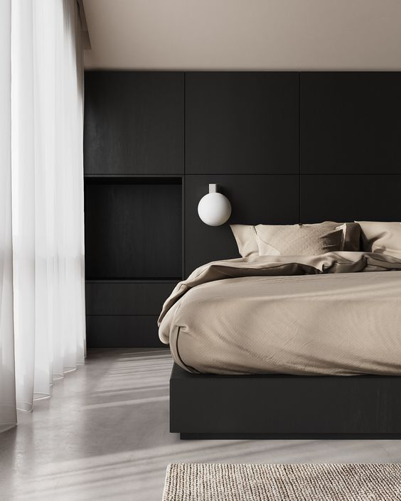 a super stylish minimalist bedroom with a black storage headboard and a black bed, bubble sconces and neutral bedding