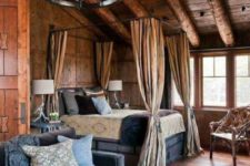 a vintage-inspired chalet bedroom with a canopy bed, a vintage chandelier, velvet furniture and an old chest for storage