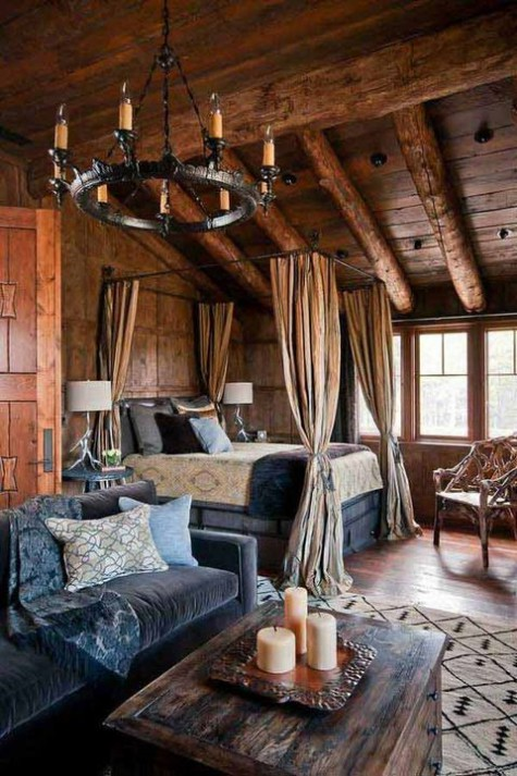 a vintage inspired chalet bedroom with a canopy bed, a vintage chandelier, velvet furniture and an old chest for storage
