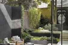 an ultra-modern monochromatic backyard with greenery all around, modern furniture