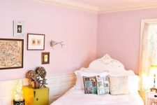 03 a whimsy bedroom with light pink walls, a gallery wall, a shabby chic bed and printed pillows plus lights