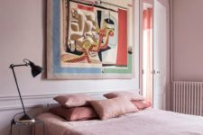 04 a chic bedroom with light pink walls, pink bedding and a statement artwork and a polka dot lamp