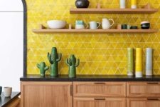 04 a mid-century modern kitchen with wooden cabinets and black countertops plus lemon yellow tiles on the wall
