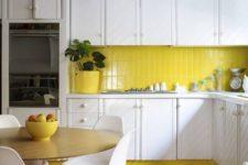 05 a modern white kitchen with a stripe pattern and a lemon yellow tile backsplash and a matching pendant lamp