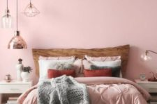 06 a chic and welcoming bedroom with light pink walls, light pink and white bedding for a soft and tender touch