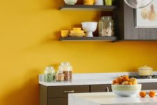 06 a sunny yellow accent wall brightens up a brown and neutral kitchen and makes it bold and cool