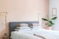 07 a boho chic bedroom with a light pink accent wall, an upholstered bed, pastel bedding and a printed rug
