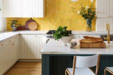 07 a stylish neutral kitchen with a hunter grene kitchen island and a sunny yellow zellige tile backsplash for a bright touch