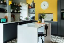 08 a graphite grey kitchen with white tiles and a sunny yellow touch over the cooker to make the kitchen more cheerful