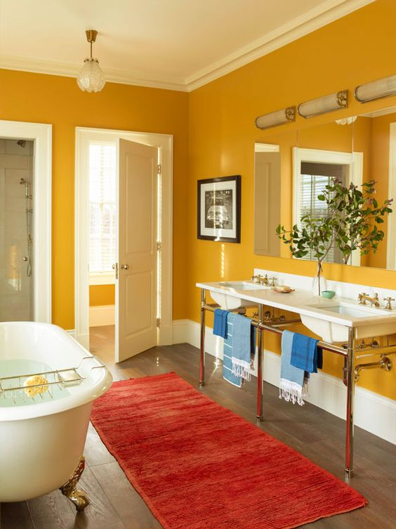 a vintage-inspired mustard bathroom with white for a fresh look, vintage appliances and fixtures