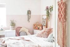 09 a boho chic space infused with light pink color block walls, pink bedding and a macrame hanging