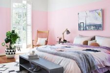 10 a bright bedroom with light pink color block walls, colorful bedding and a color block pillow