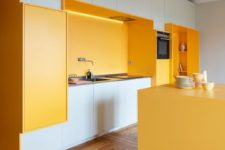 10 a bright kitchen done in white with sunny yellow niches and a kitchen island is very cheerful
