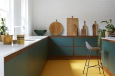 12 a bright mid-century modern kitchen with teal cabinets and a yellow floor that warms up the space