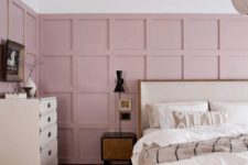12 a gorgeous mid-century modern bedroom with pink panels on the walls and a soft pink rug to soften the monochromatic space