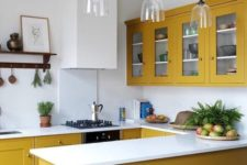13 a chic contemporary kitchen in mustard, with all white everything is a bold and stylish option
