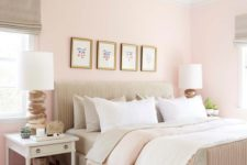 13 a welcoming eclectic bedroom with light pink walls, neutral textiles and upholstery, a woven lamp and white nightstands