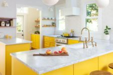 14 a chic farmhouse kitchen with sunny yellow cabients and all neutrals around feels airy and bright