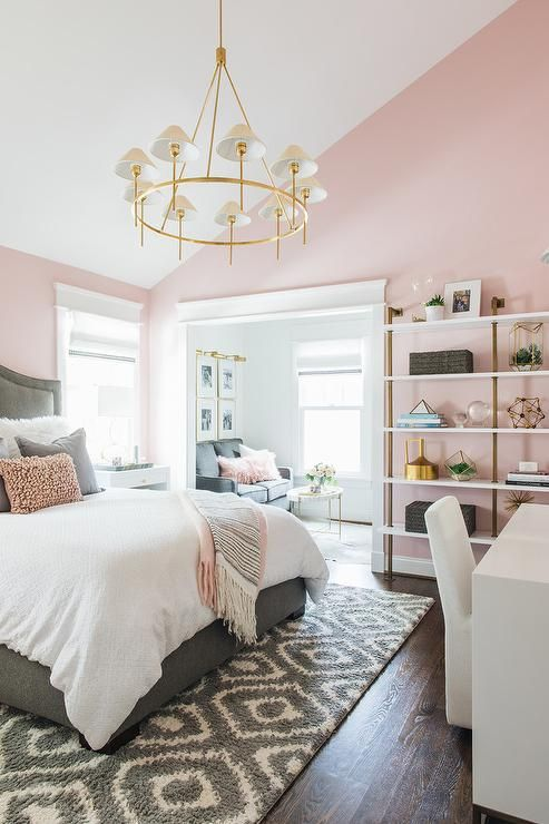 a stylish mid-century modern bedroom with light pink walls and grey, white and gold everything is very elegant