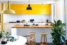 16 a contemporary white kitchen with sunny yellow upper cabinets that make it feel outdoorsy and bright