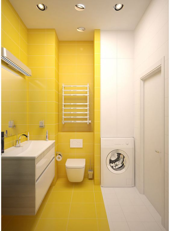 a minimalist sunny yellow and white bathroom with a color block effect and a floating vanity plus a built in washing machine