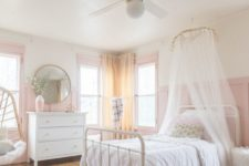 16 a romantic and airy girlish bedroom with pink panaled walls, a pink vase and window frames