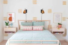 18 a bright bedroom with a mid-century modern feel and a pink ceiling and pink pillows for a soft touch