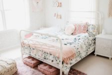 19 a chic bedroom in neutrals infused with pink – a pink rug, cushions, pillows, a blanket and some artworks and books