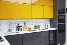 19 a modern kitchen in graphite grey and yellow, with a white subway tile backsplash and a white stone countertop