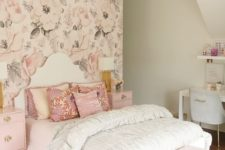 21 a girlish bedroom with a floral wallpaper wall, pink nightstands and ottomans, a pink tassel chandelier and printed pillows