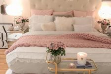 22 a glam bedroom with pink pillows, a blanket, some cushions and touches of shiny gold