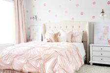 23 a lovely bedroom with light pink curtains and a draped bedspread and pillows plus a pink polka dot wallpaper wall