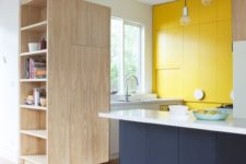 23 a stylish minimalist kitchen done in white, yellow and navy, with no handles looks bright and bold