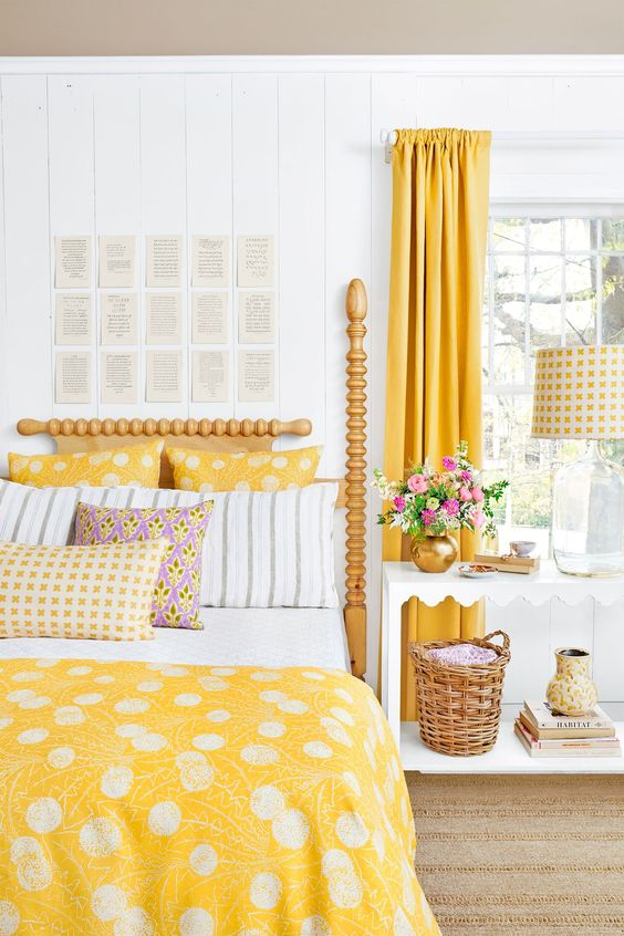 a cozy farmhouse bedroom with sunny yellow curtains and matching bright bedding to bring the space to life