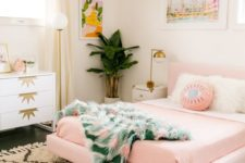 24 a mid-century modern bedroom with a glam feel shows off a pink floating bed and pink bedding for a soft touch