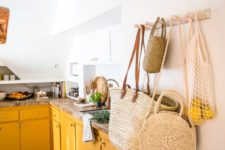 24 a stylish white kitchen with warm yellow cabinets and stone countertops looks very welcoming and sunny