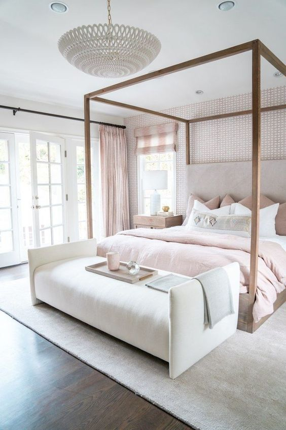 a refined glam neutral bedroom spruced up with blush textiles - curtains, pillows and a bedspread looks cool