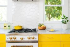 25 a vivacious yellow kitchen with white tiles and neutral stone countertops brings a fresh and airy feel