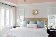 26 a refined mid-century modern bedroom with a pink ceiling, pink and blush ottomans for softening the color scheme