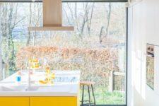 a cool yellow kitchen island makes a statement