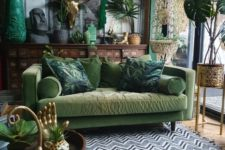 a gorgeous and moody green boho living room design
