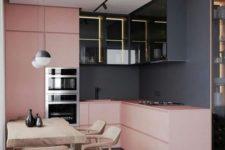 a bold modern kitchen with black walls, light pink sleek cabinets, lit up black upper cabinets